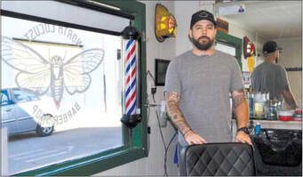 Matt Ropp waits for customers inside his recently opened barber shop, North Locust Barber Shop, at 109 N. Locust St. in Urbana.