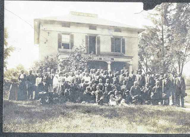 "In this 1910 photo of Curry School, 325 E. Water St., Urbana, the ""Wake Up Black America"" group is shown in front. The school focused on black education, but was open to all races. The school opened in 1898 and closed in 1917."